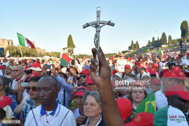 Faithful attend a Pentecost vigil prayer presided by Pope Francis on the occasion of the Golden Jubilee of the Catholic Charismatic Renewal on June 3...