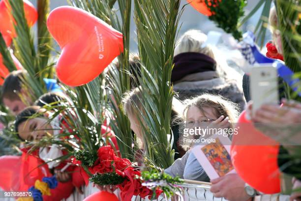 Faithful attend Palm Sunday Mass held by Pope Francis at St Peter's Square on March 25 2018 in Vatican City Vatican Pope Francis on Sunday presided...