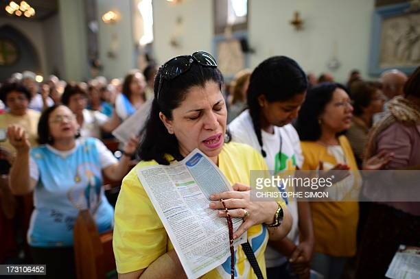 Faithful attend the mass officiated by Cardinal Stanislaw Rylko to celebrate the arrival in Brazil of the relics of blessed John Paul II at the...
