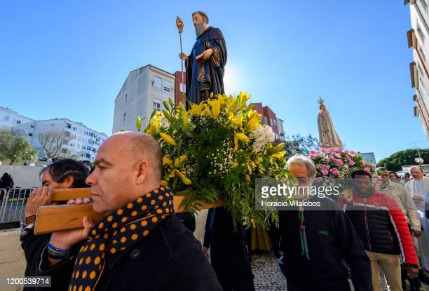 Faithful carry the figures of Santo Amaro and the Virgin of Fatima during a procession part of the Festivities of Santo Amaro a religious event based...