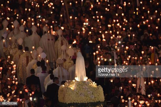 Faithful carry the statue of Our Lady of Fatima at Fatima shrine in Fatima on May 12 2017 Two of the three child shepherds who reported apparitions...