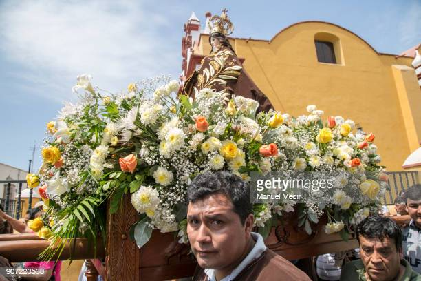 Faithful carry the Virgen del Carmen to the Trujillo Cathedral during Pope Francis 4day apostolic visit to Peru on January 19 2018 in Trujillo Peru