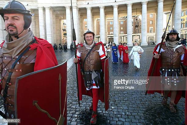 Faithful dressed as old Romans gather in St Peter's Square during the Feast of the Epiphany attend the Pope Francis' Angelus blessing on January 6...