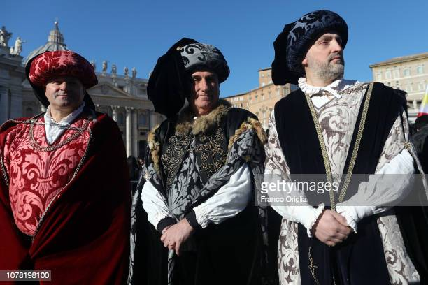 Faithful dressed as three Magi gather in St Peter's Square during the Feast of the Epiphany to attend the Pope Francis' Angelus blessing on January 6...