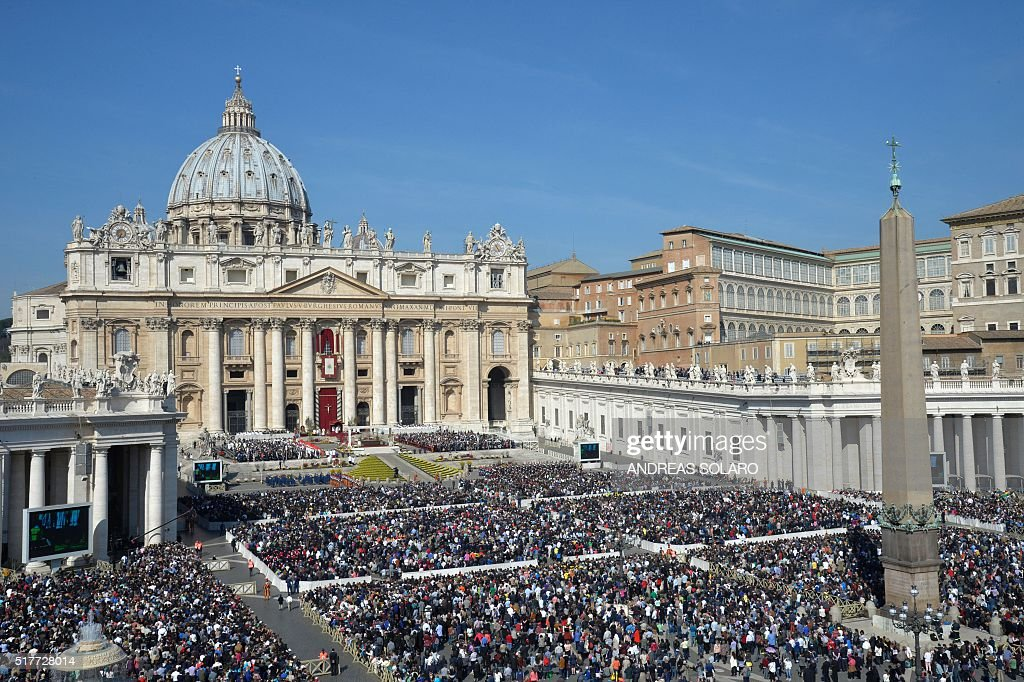 Faithful gather at St Peter's square during the Easter Sunday mass on March 27, 2016 in Vatican. Christians around the world are marking the Holy Week, commemorating the crucifixion of Jesus Christ, leading up to his resurrection on Easter.