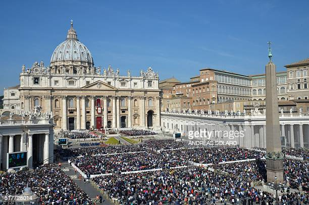 Faithful gather at St Peter's square during the Easter Sunday mass on March 27 2016 in Vatican Christians around the world are marking the Holy Week...