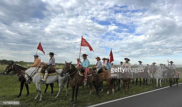 Faithful in gaucho attire take part in the Cavalcade of the Faith in honour of folk saint Gauchito Gil that will travel between the cities of Goya...