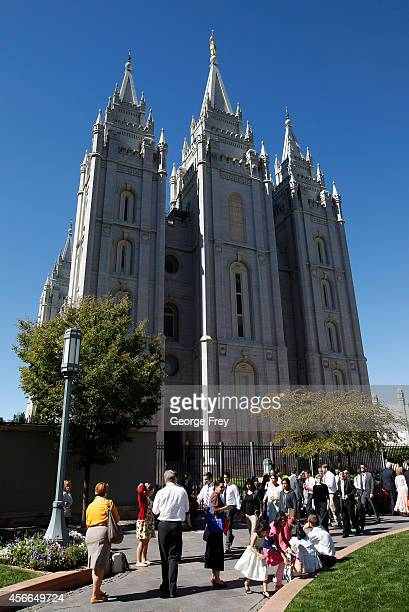 Faithful Mormons walks past the historic Salt Lake Mormon Temple between sessions of the184th Semiannual General Conference of the Church of Jesus...