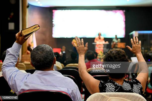Faithful pray at an evangelical church in Brasilia on September 21 2018 for the recovery of the health of Brazilian rightwing presidential candidate...