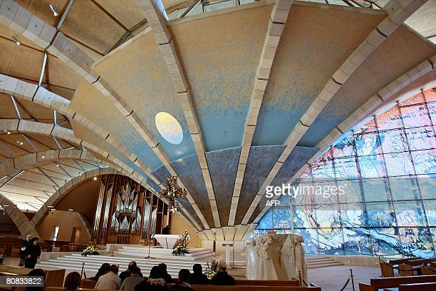 Faithful pray in the Renzo Piano Church of San Pio at San Giovanni Rotondo in the Puglia region in southern Italy on April 23 2008 on the eve of the...
