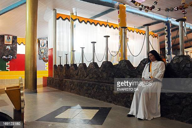 A faithful prays in a temple in Vale do Amanhecer a mystical city four kilometres from Brasilia on April 29 2013 The Vale do Amanhecer is the largest...