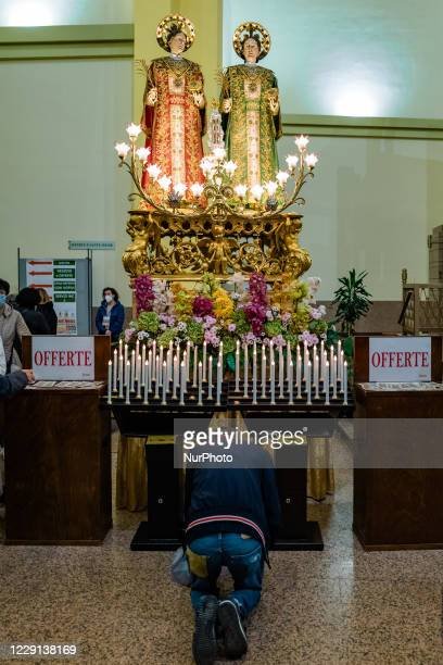 A faithful prays in front of the Statue of the Santi Medici present in the Basilica Santuario of the Santi Medici in Bitonto on October 18 2020 For...