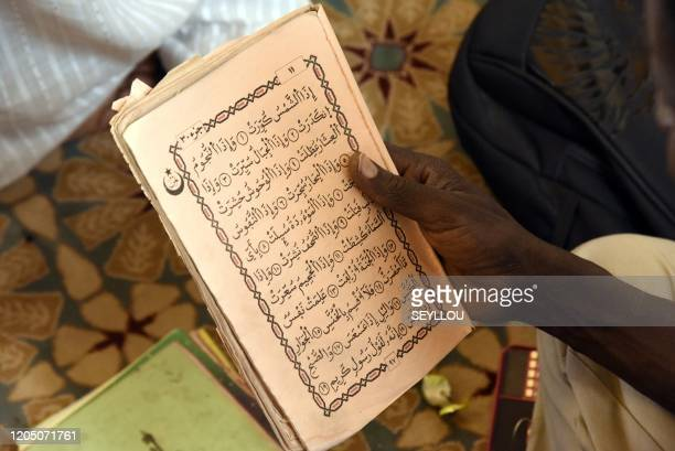 A faithful reads the Koran as faithfuls gather at the call of the Khalif general who asked for collective readings of the Koran in the context of the...