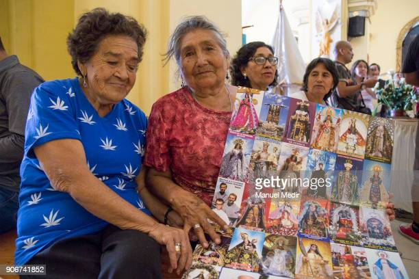 Faithful show a poster with religious images at Trujillo Cathedral prior the mass of Pope Francis as part of his 4day apostolic visit to Peru on...