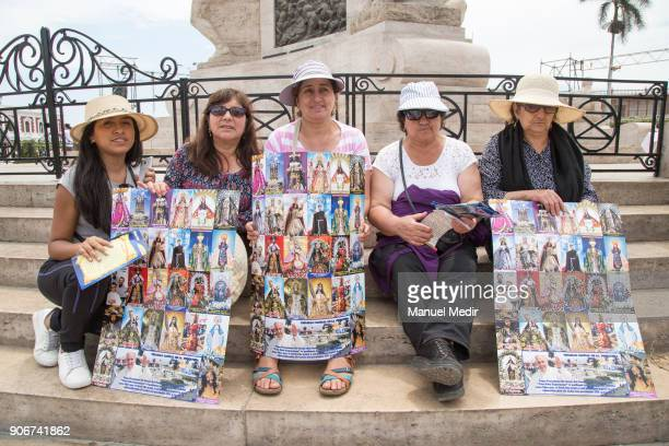 Faithful show posters with religious images at Trujillo Cathedral prior the mass of Pope Francis as part of his 4day apostolic visit to Peru on...