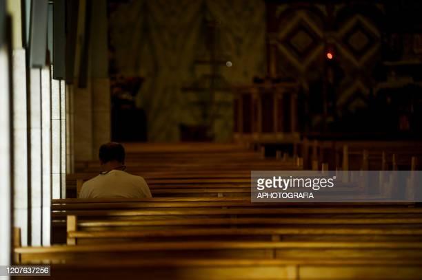 A faithful sits alone at a church on March 18 2020 in San Salvador El Salvador Despite no cases of COVID19 have been confirmed in El Salvador it's...