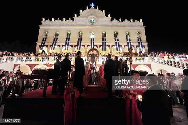 Faithful take part in the celebrations of the Orthodox Easter at the Panagia main church at the island of Tinos on May 4 2013 AFP PHOTO / LOUISA...