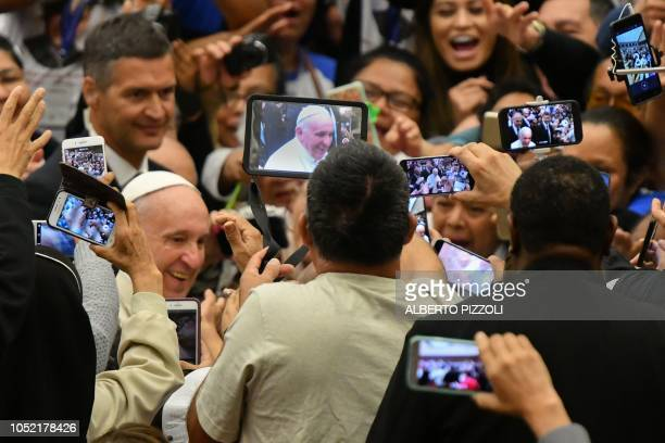 TOPSHOT Faithful take photos of Pope Francis with their mobile phone as he arrives for an audience with Salvadorian pilgrims on October 15 2018 at...