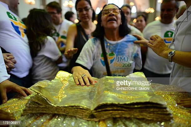 A faithful touches a relic after a mass officiated by Cardinal Stanislaw Rylko to celebrate the arrival in Brazil of the relics of blessed John Paul...