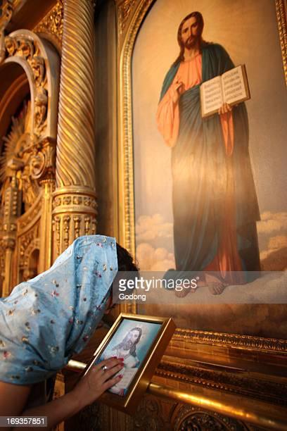 Faithful touching an icon in St Stephen's Bulgarian church