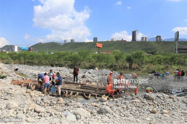 Faithful walk as workers from the municipality remove stones during a visit to pray for the recently unearthed sculpture of the Virigin of Guadalupe...