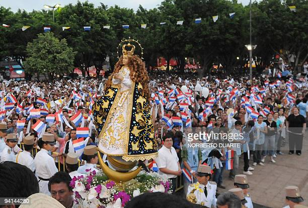 Faithful watch the passage of the Holy Virgin of Cacupe during her Patron's Feast December 8 2009 in Caacupe 50 km east of Asuncion AFP PHOTO...