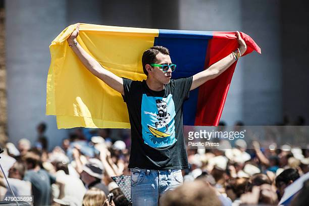A faithful waves a Colombia flag during the Angelus prayer on the Solemnity of Saints Peter and Paul in Vatican City June 29th marks the Feast day of...