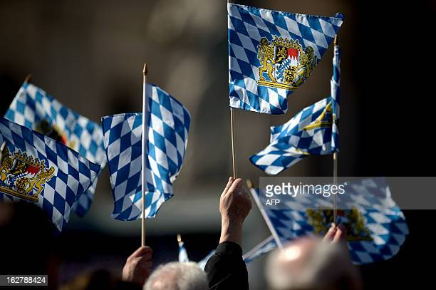 Faithful waves flags from Bavaria during Pope Benedict XVI's last weekly audience on February 27 2013 at St Peter's square at the Vatican Pope...