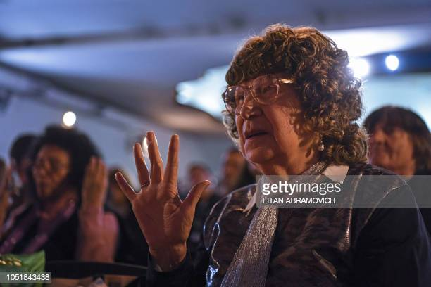 A faithful woman prays during a meeting at Pastor Gimenez's Church located in the former Roca cinema of Almagro neighborhood in Buenos Aires...