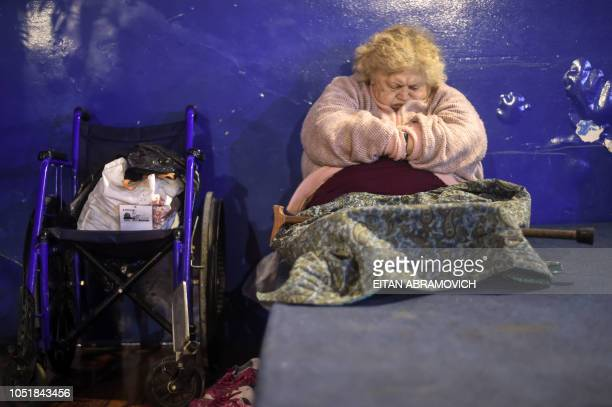A faithful woman sleeps during a meeting at Pastor Gimenez's Church located in the former Roca cinema of Almagro neighborhood in Buenos Aires...