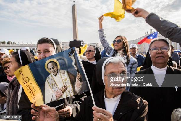 Faithfuls attend the canonisation ceremony presided by Pope Francis of seven new Saints including Pope Paul VI and Archbishop Oscar Romero at Vatican...