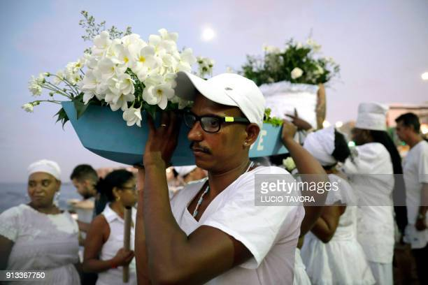 Faithfuls carry offerings to Yemanja the goddess of the sea from the ancient Yoruba mythology and one of the most popular deities of the...