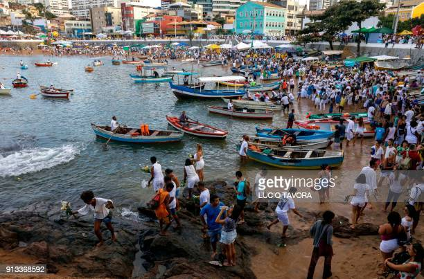 Faithfuls gather at Rio Vermelho beach in Salvador Bahia state Brazil during celebrations of Yemanja day the goddess of the sea from the ancient...