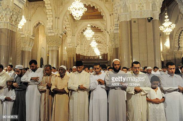 Faithfuls listen to Imam Omar Kzabri at the Hassan II mosque during the Tarawih prayers as part of the Muslim holy month of Ramadan in Casablanca on...