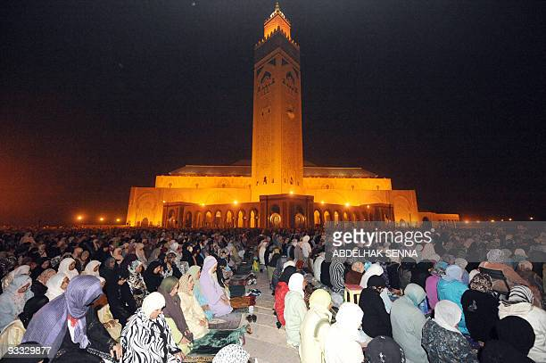 Faithfuls listen to Imam Omar Kzabri on the esplanade of the Hassan II mosque during the Tarawih prayers as part of the Muslim holy month of Ramadan...