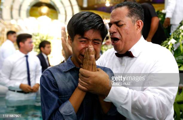 Faithfuls participate in the baptism day of the 'La Luz Del Mundo' church in Guadalajara State of Jalisco Mexico on June 23 2019 The international...