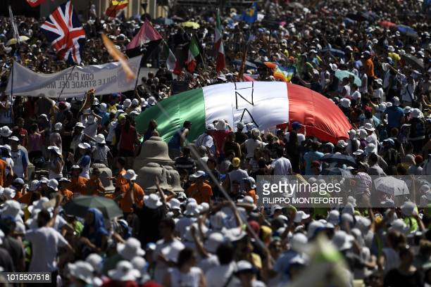 Faithfuls wait for the Pope's Angelus prayer at St Peter's square in the Vatican on August 12 2018