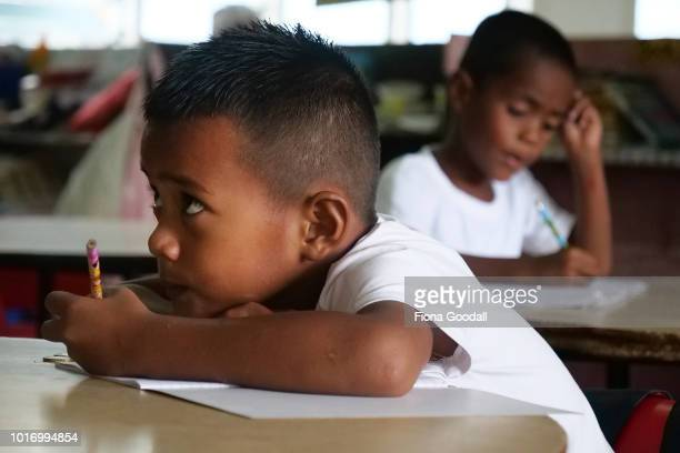 Faiva Nete works on his handwriting at school on August 15, 2018 in Funafuti, Tuvalu. Nauti Primary school is one of two on the main island where...