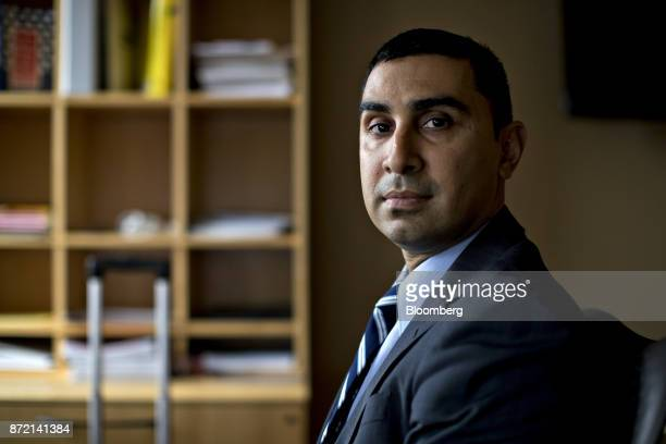 Faiz Shakir national political director with the American Civil Liberties Union sits for a photograph in Washington DC US on Tuesday Nov 7 2017 The...