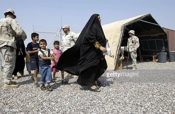 Faiza Na'man Mohamed and her five children arrive for visitation at Camp Bucca a USrun detention center in southern Iraq They are paying a visit to...