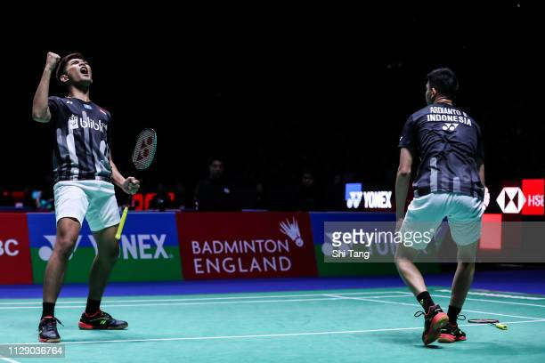 Fajar Alfian and Muhammad Rian Ardianto of Indonesia celebrate the victory after the Men's Doubles second round match against Ren Xiangyu and Ou...