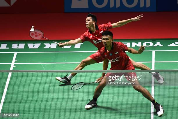 Fajar Alfian and Muhammad Rian Ardianto of Indonesia compete against Liu Cheng and Zhang Nan of China during the Men's Doubles Quarterfinal match on...
