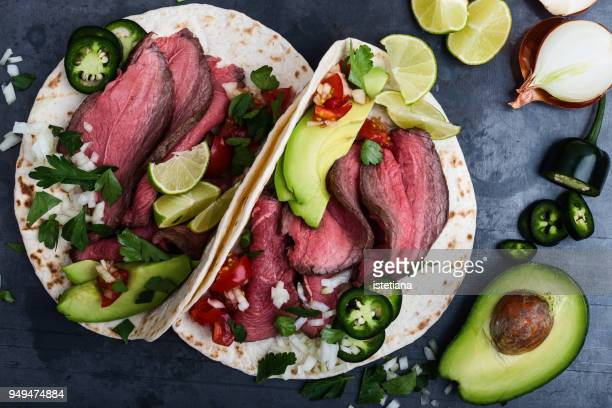 Fajitas with beef steak and vegetables on wheat flour tortillas