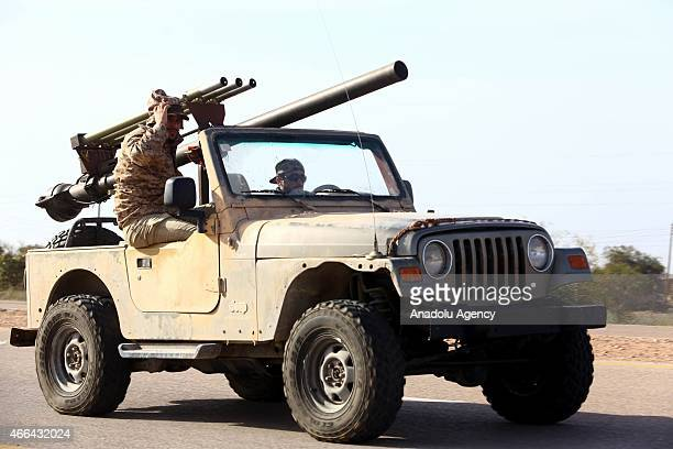 Fajr al-Libya forces are seen as they deploy on a check point on a road at the entrance of the city in Sirte, Libya on March 15, 2015.
