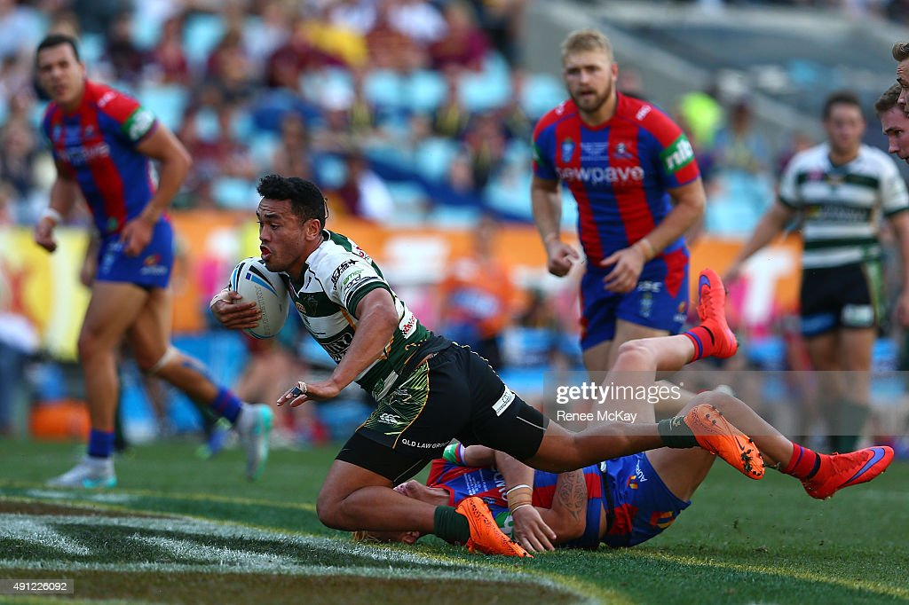 Fakahoko Teutau of the Jets is tackled during the 2015 State Championship Grand Final match between Ipswich Jets and the Newcastle Knights at ANZ Stadium on October 4, 2015 in Sydney, Australia.