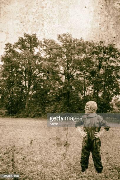 fake alien old photo - scaredastronaut stock pictures, royalty-free photos & images