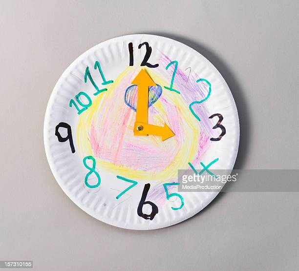 fake clock - paper plate stock photos and pictures