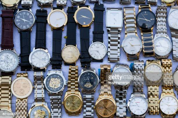 fake counterfeit wristwatch bangkok thailand - brand name stock pictures, royalty-free photos & images