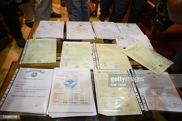 Fake degree certificates recovered by the Delhi crime branch in New Delhi on Saturday