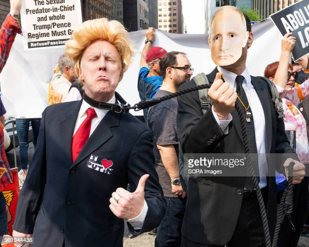 A fake Donald Trump on a leash held by a fake Vladimir Putin at a protest rally against Donald Trump outside the Lotte New York Palace Hotel in New...